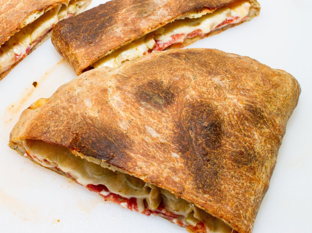SERVE THE CALZONE WITH A LIGHT SIDE SALAD