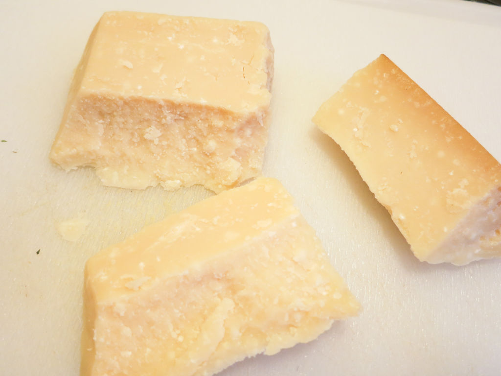 Parmigiano Reggiano ready to be grated using a microplane