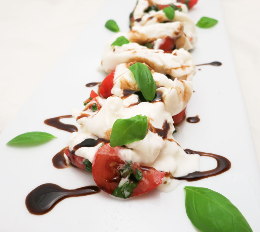A SIMPLE DRIZZLE OF BALSAMIC GLAZE AND A FEW BASIL LEAVES HAVE A BIG IMPACT ON THE FINAL PRESENTATION
