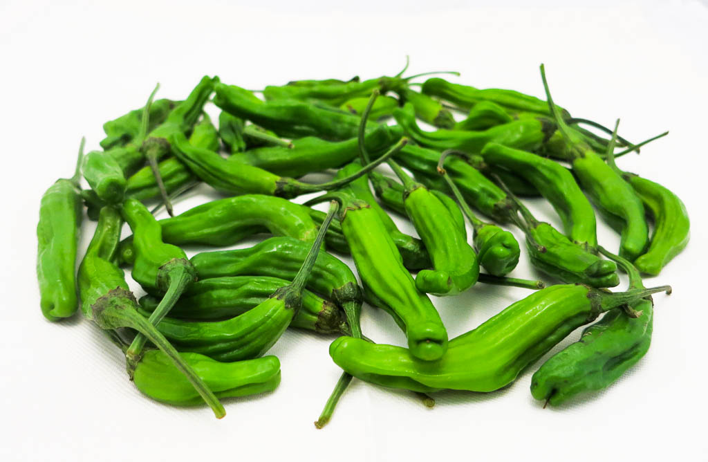 Sautéed Shishito Peppers are the new edamame. At least in my house they are!