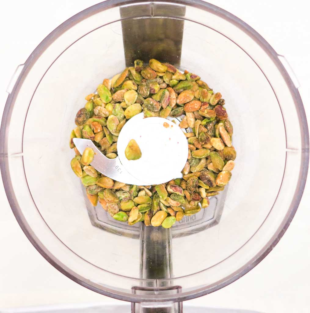 Quickly pulse shelled pistachios in the food processor. Don't pulse too much. You want pistachio pieces, not pistachio dust!